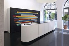 Contemporary kitchen design ideas bring simple and elegant shapes, contrasting or bright colors