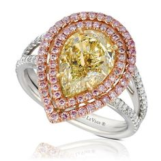 Stunning pear shaped 3.21 carat Fancy Natural Yellow Diamond center framed with Vanilla Diamonds and Fancy Natural Pink Diamonds totaling 3.77 carats set in Platinum and 18K Gold. Style