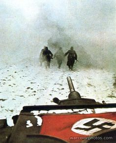 A German Panzer following its infantry support in Russia, Winter 1941/42.
