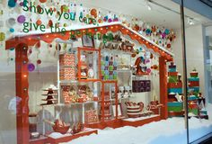 love the house idea.  hanging ornaments or snowflakes.  snow on ground.