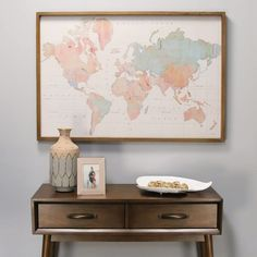 """Enjoy charting your next adventure with the Watercolor World Map Print Wall Art. This beautifully printed map features warm to cool shades of pink and blue on a white background and a handcrafted wooden frame, imparting a sophisticated Old World feel that calls to mind a map that might have been used by great explorers. Measures 44"""" W x 1.50"""" D x 30"""" H and comes ready to hang horizontally on the wall.Case Pack: 1Color: MultiMaterial: 60% MDF, 40% Fir woodFinish: MultiNumber Of Cartons: 1 Framed World Map, World Map Wall Art, Framed Maps, Framed Wall Art, Wall Maps, Wall Décor, Map Art, World Map Design, World Map Decor"""