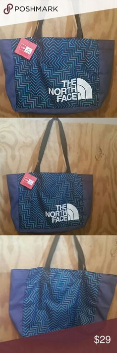 The North Face Medium Loop Tote NWT The North Face  Medium Loop Tote  New with tags!   Perfect bag to carry everywhere, school, beach, pool.  Big enough to fit a large laptop or towel or books, clothes, whatever you need!  Has inner cell pocket, no zipper, no outer pockets  Great blue/black pattern with white TNF logo The North Face Bags Totes
