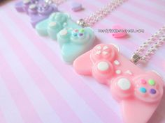 These are so cute XD  Pastel Mini PlayStation Controller Necklace by NerdyLittleSecrets