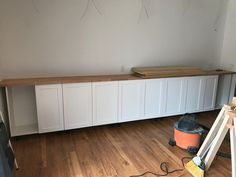 All about how we DIY'd our built in bookshelves using IKEA cabinets. Custom Bookshelves, Decorating Bookshelves, Bookshelves Built In, Bookcases, Home Office Cabinets, Ikea Cabinets, Built In Cabinets, Home Office Space, Home Office Design