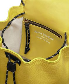 d076b7566f5c Acne Studios Rope jungle yellow is a small leather backpack with large  whipstitch details perfect for daily use.