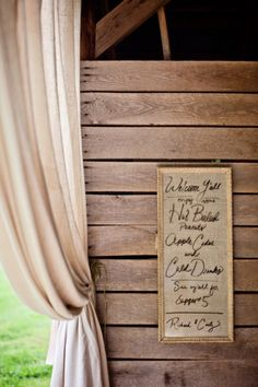 Wedding Signage on burlap and framed. Love the added draping.