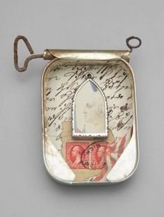 Sardine Tin Can Brooch  2001   Robert W. Ebendorf   Overall: 12.7 x 10.5 x 2.9 cm, 44.4 gm (5 x 4 1/8 x 1 1/8 in., 0.1 lb.)   Paper, postage stamps, tin, and other mixed media   Classification: Jewelry / Adornment  Museum of Fine Arts, Boston