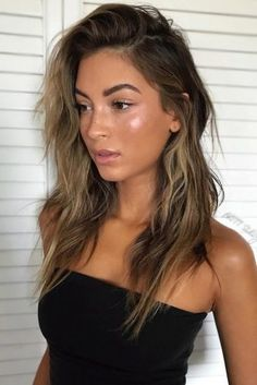 This beachy ombre look mixes shades of dark brown and blonde, complementing olive skin tones and summertime.