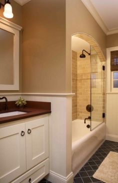 Love this idea for the shower.  I really wanted the kids to still have a tub, but really like the idea of no shower curtain!