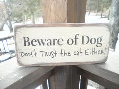 funny pet sign beware of dog don't trust the cat