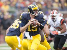 Michigan Wolverines quarterback Jake Rudock looks for