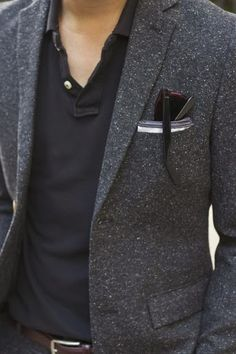 gray tweed jacket. black polo shirt. jeans.  white pocket square w/gray piping. black belt. simple. easy. fall. casual. style.