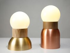 The Wedding table lights by Asaf Weinbroom, so called because they are in the form of simple silhouettes of a man and a woman, apparently. Copper or brass, with wood and glass.