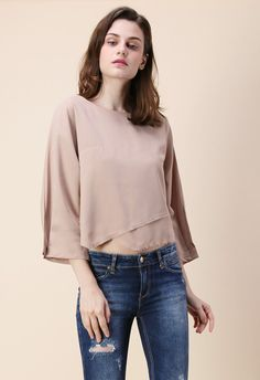 Getting+gorgeous+is+light+work+when+you+step+out+in+this+simplistic+tan+smock+top+boasting+tiered+asymmetric+hemline+with+raw+trim+that+says+screams+'casual+glam'.