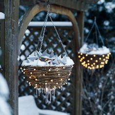 Re-purpose those summer hanging flower containers and hang them outside in the winter with Christmas lights, let the icycles form on their own.