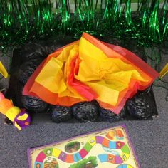 Journey Off the Map VBS campfire made with spray foam, paint, and colored tissue paper.
