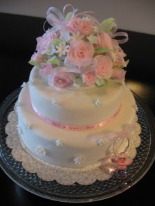 the roses could b around the tier separation with tiny pink roses where the white ones are n sumpin baby on top
