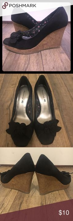 American eagle wedge heel Wedge heel from American eagle. Black with brown wedge. Peep toe with flower detail. Worn once or twice! American Eagle by Payless Shoes Heels