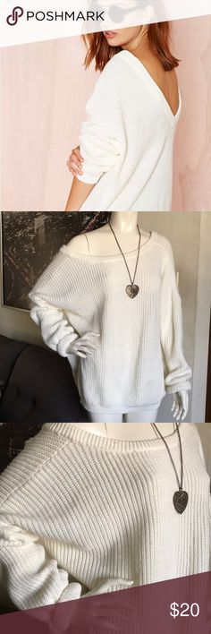 Ivory Nasty Gal oversized sweater Good condition. Bought on poshmark. Minimal stain on front as in pic but not very obvious. Chunky and oversized. V -back. Nasty Gal Sweaters