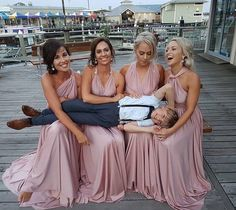 What an adorable photo of @tara__lord's bridal party & her cute page boy! Her girls look amazing in their Goddess By Nature signature ballgowns in the dust me pink colour  #wedding #bridesmaids #multiway #dresses