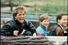 Happy mom and kids enjoying the Loggers Leap ride at Thorpe Park.