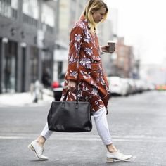 Winter Street Style From The Fall 2015 Shows | The Zoe Report Tip;forgo a monochrome coat for a whimsical, printed option.