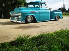 A 57 Chevy. I used to pass by one just like it, same color and everything, when I first moved to NC. The other day, one of my students had a book written by a friend of her's. The cover and its coloring reminded me of this truck. The fact that they don't make 'em like this anymore, explains why old people can be grumpy upon occasion.