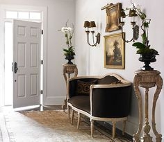 A door between the foyer and the master suite sitting room was eliminated, making room for a settee.