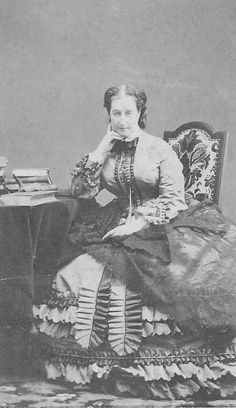 Eugénie seated with lace shawl on her lap ...George Spingler took this photo and the last one of Empress Eugenie wearing a crinoline-era dress with ruched ornaments.