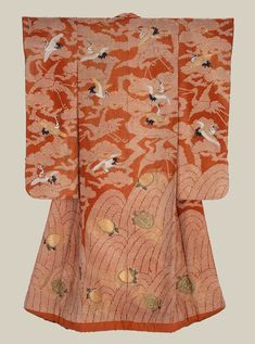 "Silk 'uchikake' (wedding over-kimono).  First half 19th century, Japan. ""Silk damask (rinzu), tie resist-dyed (kaneko shibori) and embroidered with silk and couched with gold-wrapped threads. Reddish-orange silk damask with design of tie-dyed waves at bottom embroidered with tortoises (minogame) and tie-dyed pine trees above embroidered with flying cranes (tsuru);"".  MFA. (William Sturgis Bigelow Collection)"