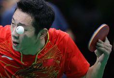 Xin Xu (CHN) hits the ball to Jun Mizutani (JPN) in a men's table tennis team finals match at Riocentro - Pavilion 3 during the Rio 2016 Summer Olympic Games.