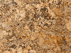 Kitchen: Solarius granite from Brazil features yellow and gold background with darker veins of brown and gray.