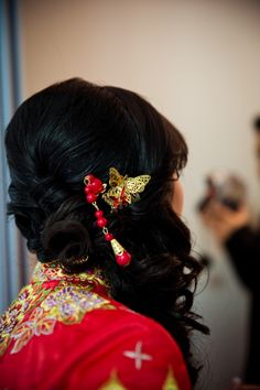 Bells N Whistles Event Wedding Clarita  Tony - Traditional Asian Wedding Hair // Interesting decision with the red and the butterfly accent...