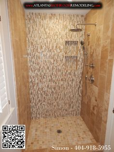 Travertine shower with glass mosaic tiles and delta shower system.