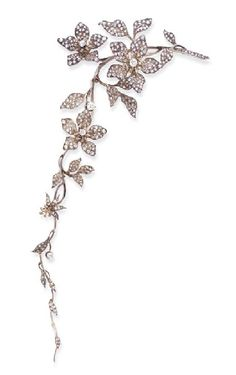 AN ANTIQUE DIAMOND BROOCH   Designed as an articulated rose, old mine and old European-cut diamond leaf and floral cascade, the flowerheads set en tremblant, mounted in silver and gold, (sections detachable), circa 1860