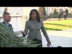 Michelle, Sunny and Bo Obama Receive White House Christmas Tree