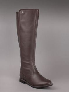 Lacoste® Women's Rosemont 4 Boot in Brown.  Every fashion forward girl needs a brown boot in her closet. You choose the Lacoste Rosemont 4 women's boot in lush brown leather, full back zip and ever present Lacoste crocodile logo on upper edge. Low heel height and rubber sole ensure the most comfortable tall boot out there.