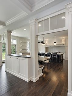 SallyL: Oxford Development - Elegant, traditional kitchen design with transom windows and pass . - My-House-My-Home Half Wall Kitchen, Kitchen Pass, Open Kitchen, Kitchen Columns, Pass Through Kitchen, Banquette Design, Banquette Seating, Kitchen Banquette, Kitchen Dining