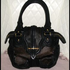 The Botkier Cairo Small Satchel Black and Brown Italian Lambskin Leather  Pony Hair Trim Hobo Bag is a top 10 member favorite on Tradesy. 5822a844e3020