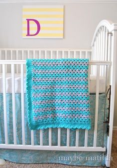 Step-by-step photo tutorial to teach you to crochet a granny stripe baby blanket!