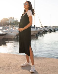 black dress casual Soft stretch jersey Midi length Stylish slits Adjustable knotted straps Perfect for layering (t-shirt sold separately) Our Black Midi Maternity Dress plays int Stylish Maternity, Maternity Wear, Maternity Dresses, Maternity Style, Maternity Fashion Wedding, Modern Maternity Clothes, Pregnancy Stages, Pregnancy Outfits, Pregnancy Info