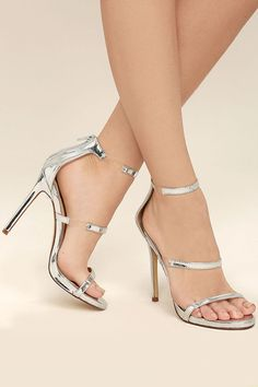"The Making Magic Silver High Heel Sandals create a sexy illusion that will have all your admirers mystified! Shiny, mirrored vegan leather forms these single sole heels with lucite accents along the strappy peep-toe upper. 3"" heel zipper."