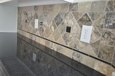 Granite Countertops and Tile with a granite inlay backsplash to tie it together!