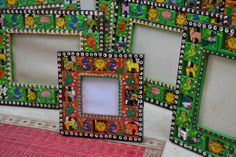 GIVEAWAY - valid anywhere in the world [ 1st may to 7th may]  A lovely addition to your children's room. Intricate carved animals are strung on this wooden photo frame handcrafted by local artisans from Benaras, India.