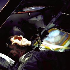 On Oct. 14, 1968, Apollo 7 transmitted the first live broadcast from a manned U.S. spacecraft. In this image, Apollo 7 commander Walter Schirra looks out the rendezvous window in front of the commander's station on the 9th day of the Apollo 7 Earth orbital mission.