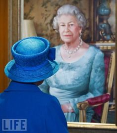 Britain's Queen Elizabeth II views a specially commissioned portrait of herself during her tour of Cunard's new cruise ship, Queen Elizabeth.