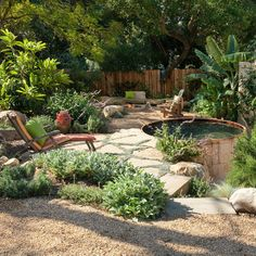 natural rocks around portable jacuzzi | Naturalist, hot tub with flagstone, Stone Fire Pit, adirondack chairs ...