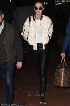 Gigi Hadid wearing J Brand 8001 Leather Skinny Pants, Versace Ryder Bag and Reebok Furylite Woven Sneakers