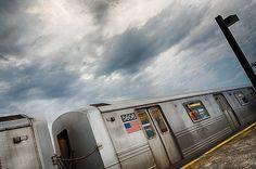 Dramatic clouds at Kings Highway subway station.