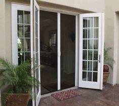 Retractable screen doors are screen doors covered by roll-up blinds that open either vertically or horizontally. The retractable screen doors are very convenient to use. French Doors With Screens, Double French Doors, French Doors Patio, Patio Doors, Windows And Doors, Double Screen Doors, Entry Doors, Patio Door Screen, French Doors Bedroom